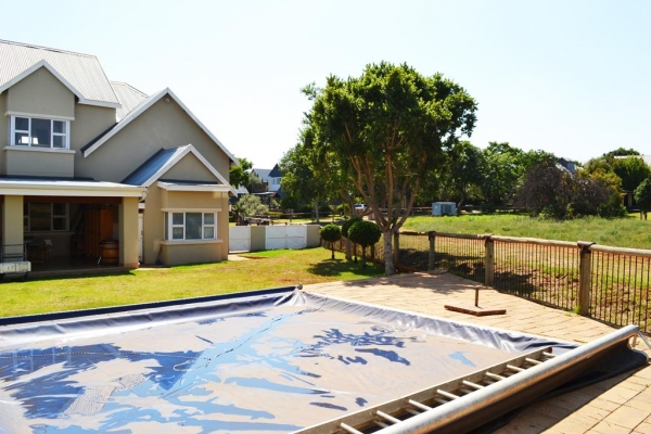 Swimming pool to house and pasture.jpg